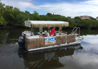 Tiki Boat Side View